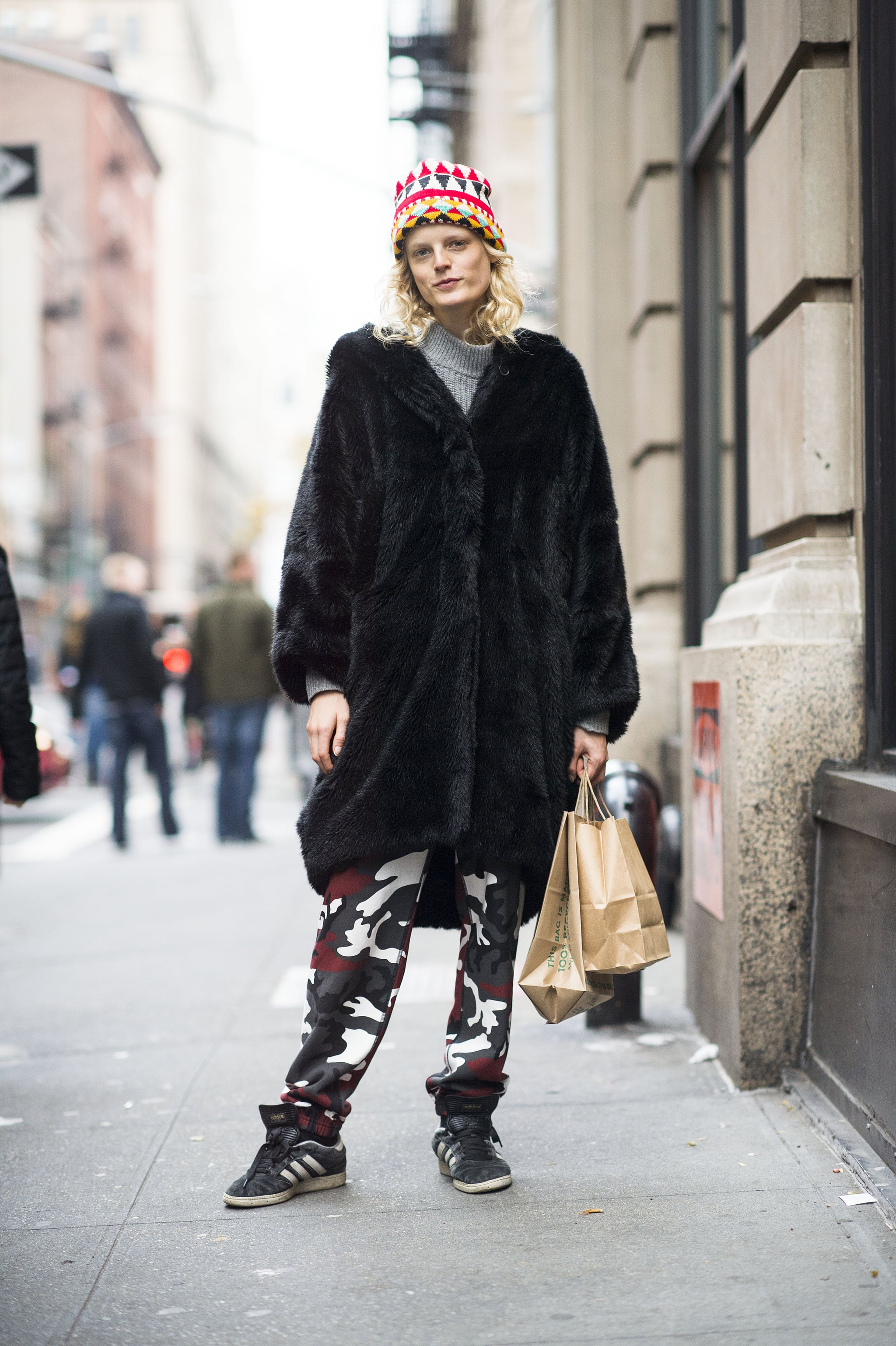 Hanne Gaby Odiele stayed spunky with camo-print pants, an oversize fur, and a bright beanie. Source: Le 21ème | Adam Katz Sinding
