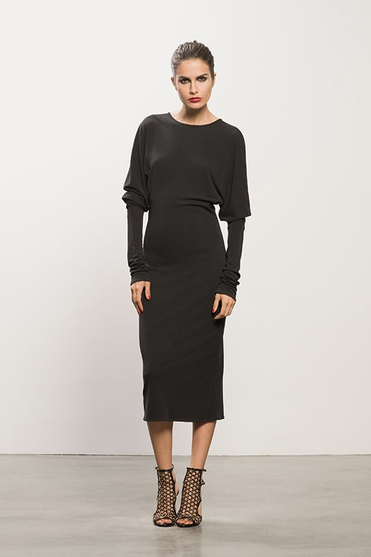 Exaggerated Long Sleeve Black Jersey Dress ($795), Submission Black Studded Sandal ($995) Photo courtesy of Tamara Mellon