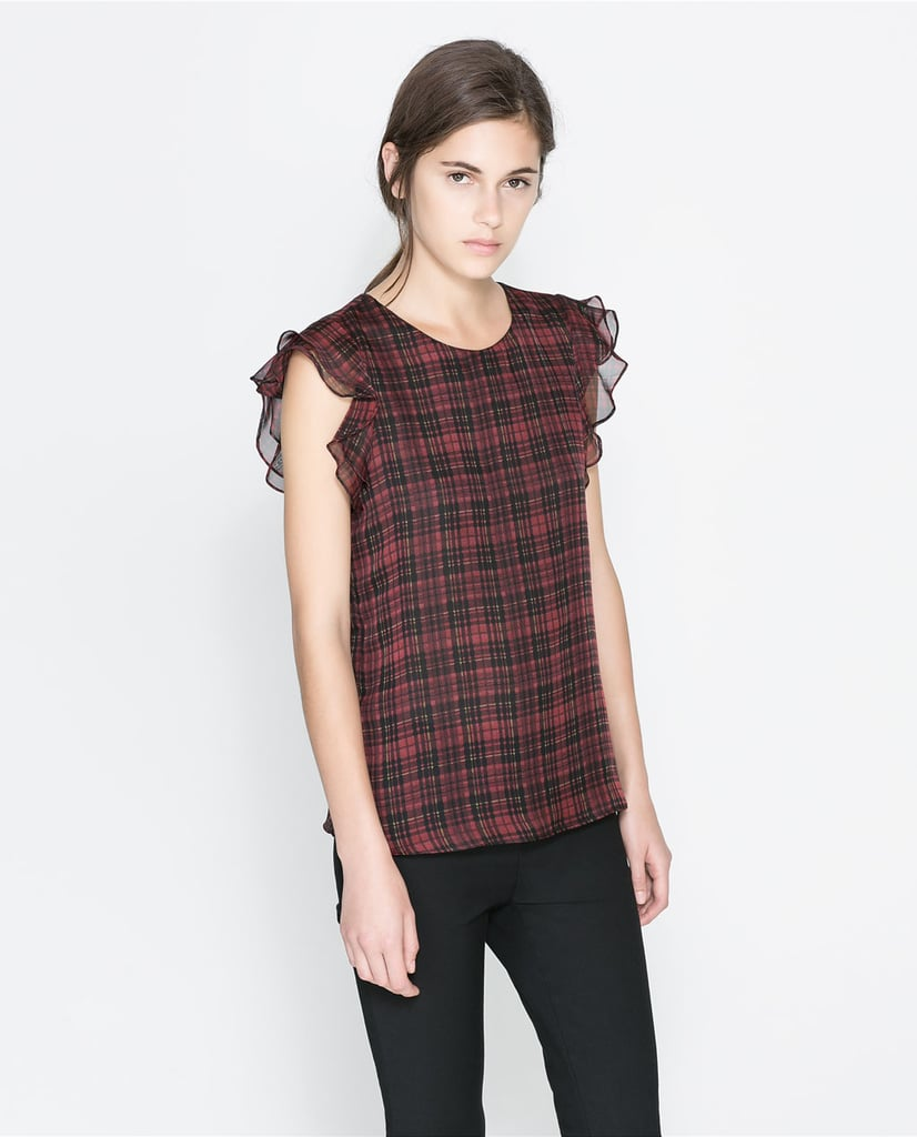 Zara's checked top with frill sleeve ($50) would look perfect with ankle-crop trousers and a pair of brogues.