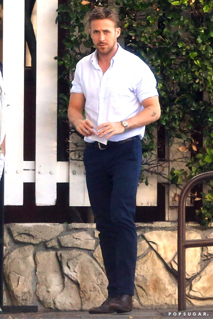 His Biceps Bulging Beneath Rolled-Up Sleeves