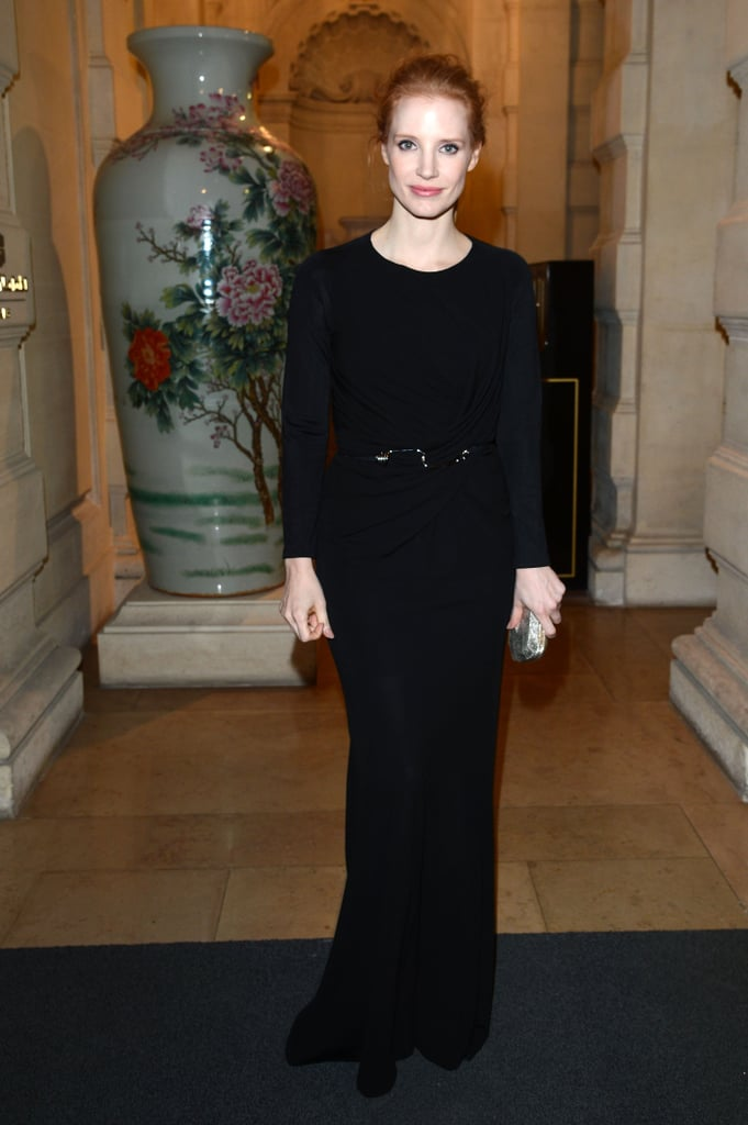Jessica Chastain wore a long black gown with a metallic clutch to the CR Fashion Book issue two party during Paris Fashion Week.