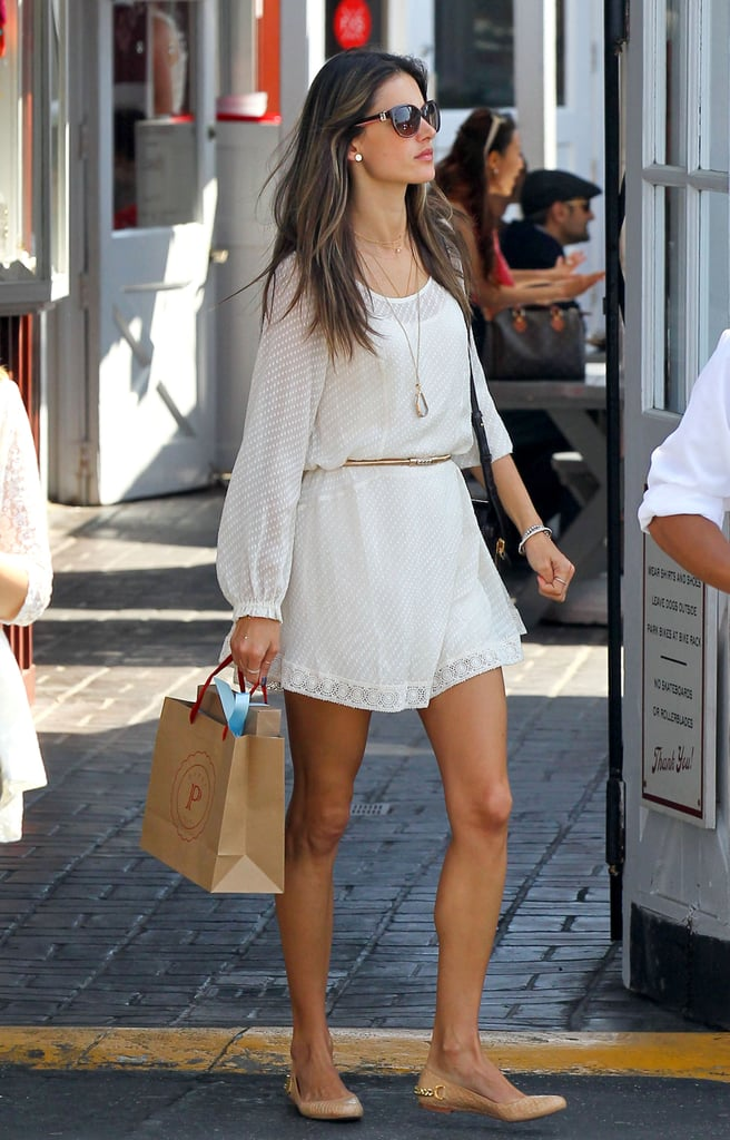 Alessandra cinched her sheer Ella Moss LWD with a gold skinny belt, then added delicate accents for an overall pretty effect. Her long gem pendant necklace and chain-embellished nude flats were low-key, albeit feminine, choices that reflected her girlie bohemian style.