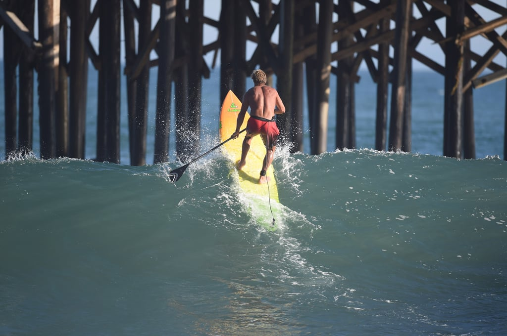 Legendary surfer Laird Hamilton took advantage of the big waves in Malibu, CA.