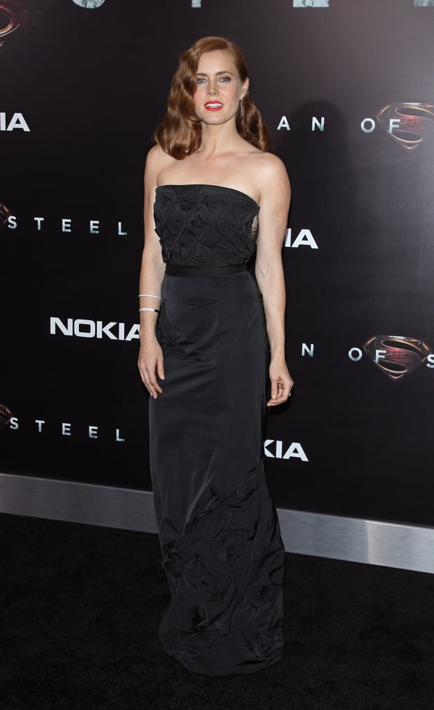 At the NYC premiere of the flick, Amy dimmed her style in a black strapless gown, then added a bold red lip for a pop of colour.