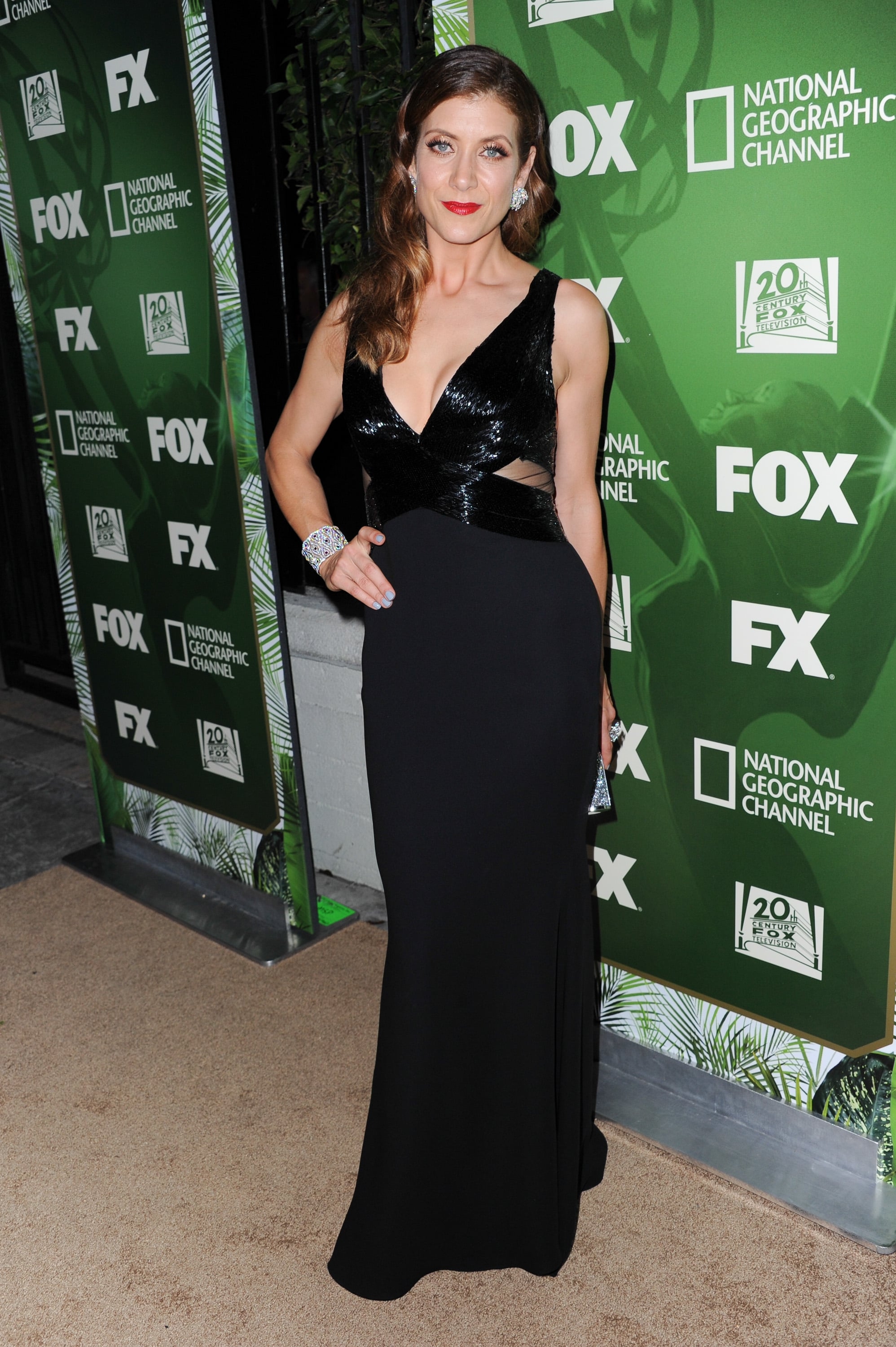 Kate Walsh changed into a low-cut black gown for her night out.