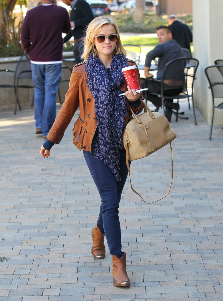 The This Means War star mixed textures to keep her tan-and-navy palette from looking boring. She topped her denim with a ruffled 3.1 Phillip Lim leather jacket, gold-toe Golden Goose boots, and a versatile Saint Laurent bag.