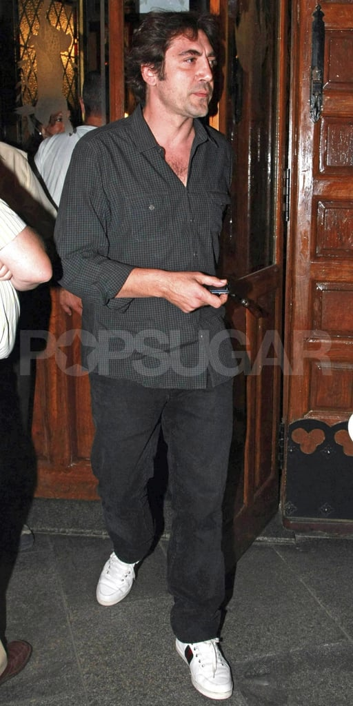 Fresh faced Javier Bardem followed his wife out of the restaurant.