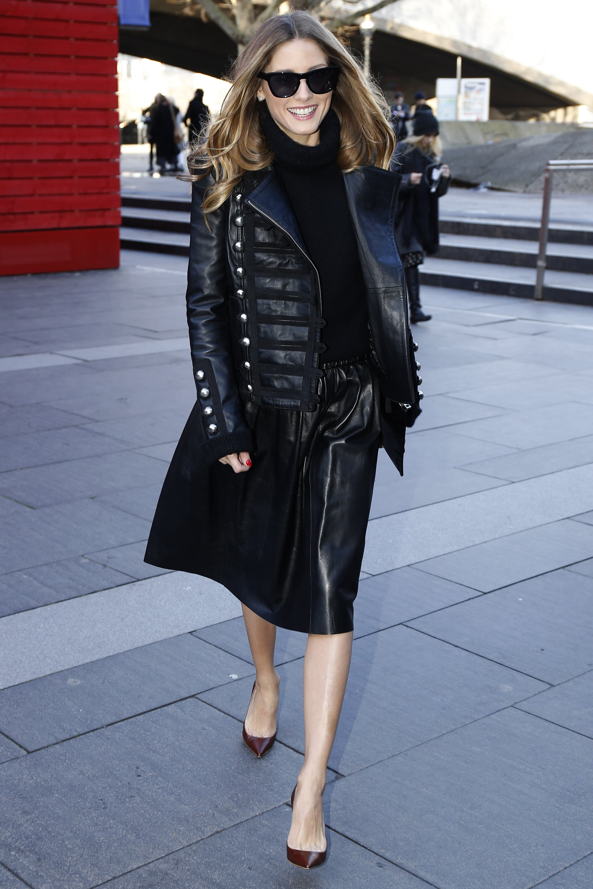 Olivia made a styled run between shows in a Reiss skirt, topped with a Boda leather jacket and Westward Leaning shades. She finished it all off with Christian Louboutins and a Whistles clutch in hand.