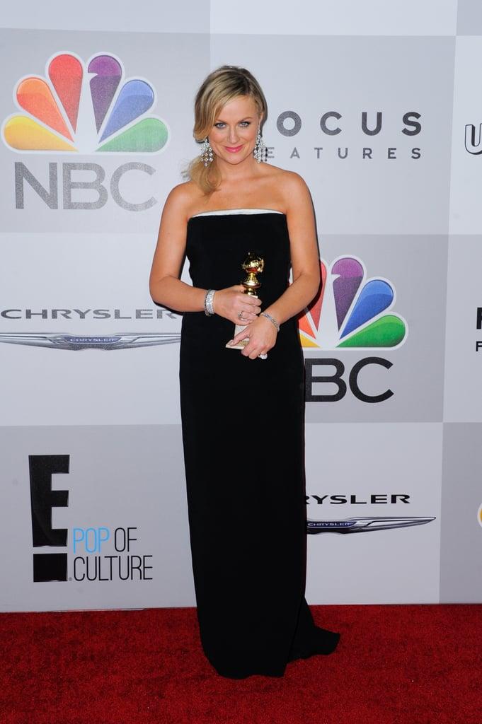 Amy Poehler showed off her award.