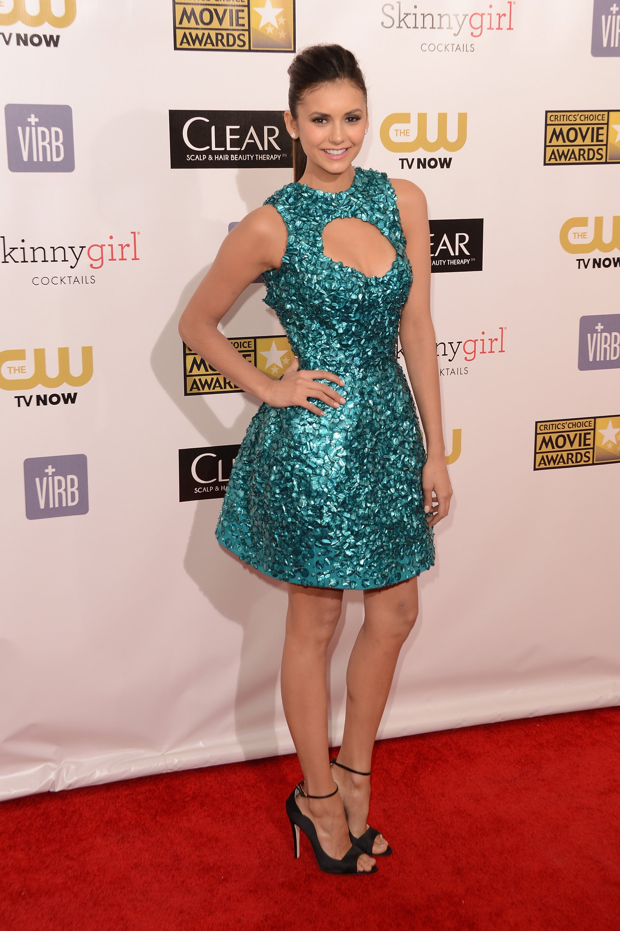 Donning a real jewel-toned Monique Lhuillier mini — zoom in to see the array of strategically placed gems — Nina Dobrev was not to be missed on the Critics' Choice Awards red carpet in January 2013.