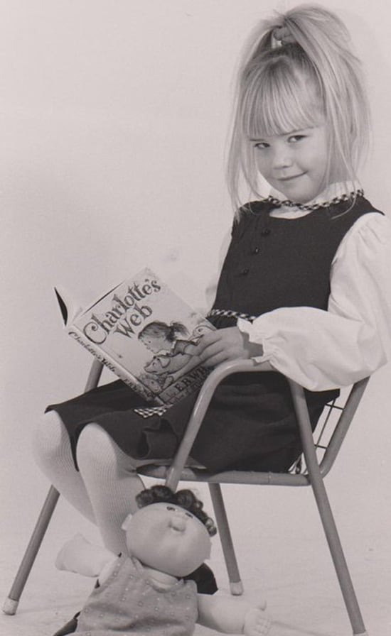"""""""Here's a headshot from when I was about 5 or 6, from my short-lived child-modeling career (let's be thankful that never took off). Once a bookworm, always a bookworm."""" —  Nicole Perry, assistant editor, POPSUGAR Food"""