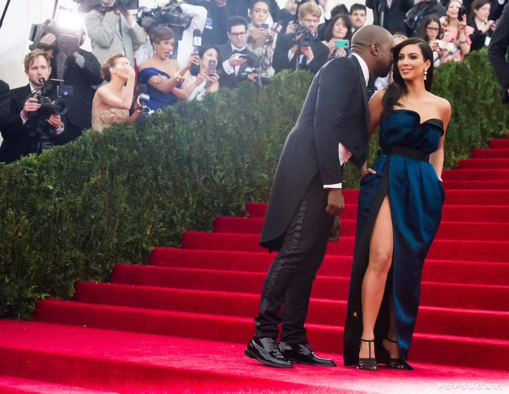 Kanye West whispered in Kim Kardashian's ear during their red carpet run.