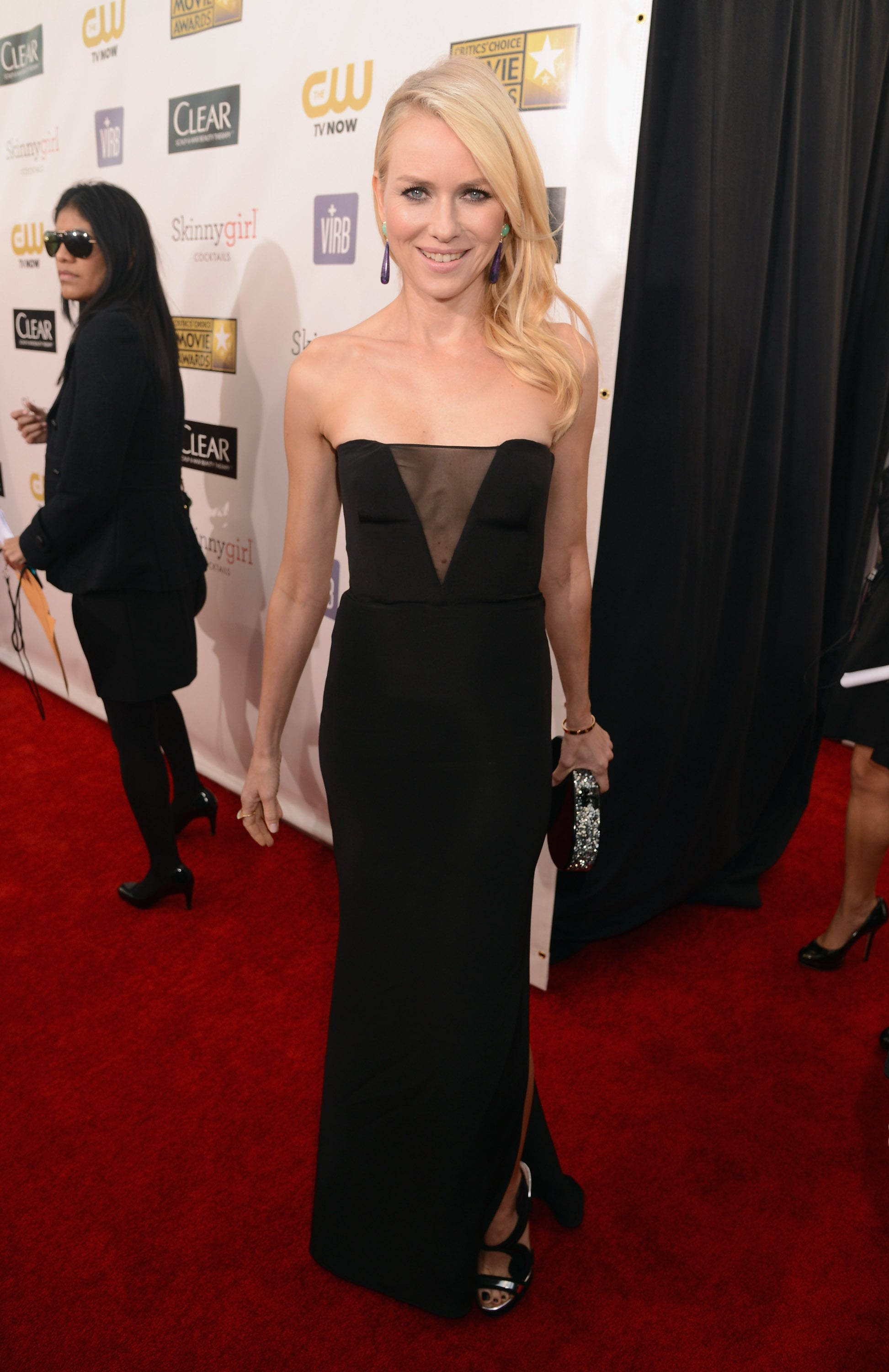 At the 2013 Critics' Choice Awards, Naomi Watts's black Emilio Pucci gown got a hint of shine via her black and silver Nicholas Kirkwood sandals, which peeped out from under her sexy side slit.