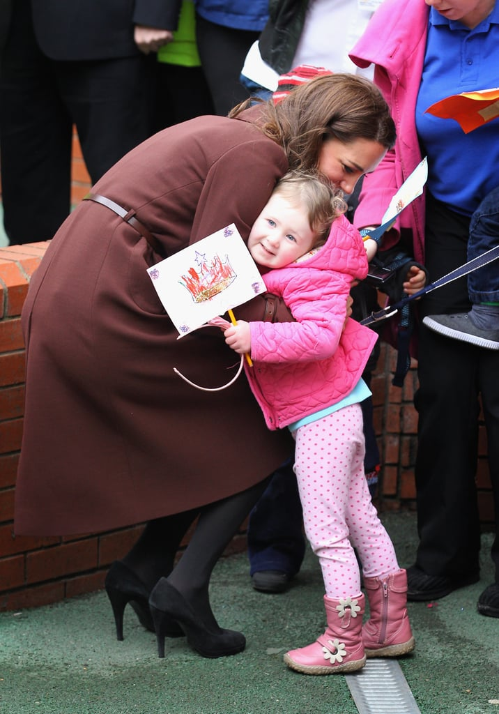 We can't get enough of this sweet photo! Kate likely made 3-year-old Nancy Williams's day when she gave her a big hug at the Alder Hey Children's Hospital in England in February 2012.