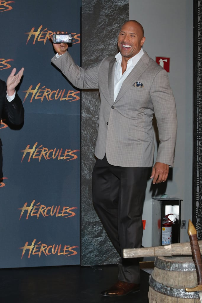 The Rock snapped photos at an event for Hercules in Mexico City on Monday.