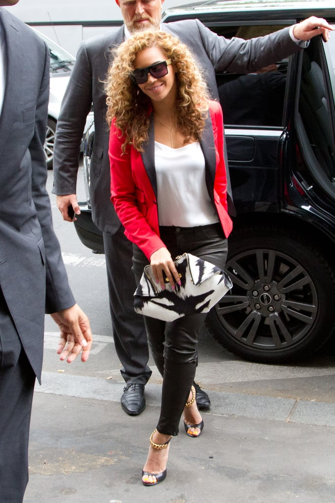 Beyoncé's fitted red blazer and black trouser look is perfect for a work event; it's got the ideal amount of laid-back glamour and office-appropriate tailoring.