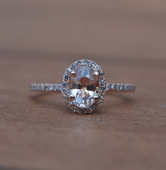 This oval cut is traditional and also has a slight vintage vibe.  Oval Champagne Peach Sapphire Diamond Ring ($203)