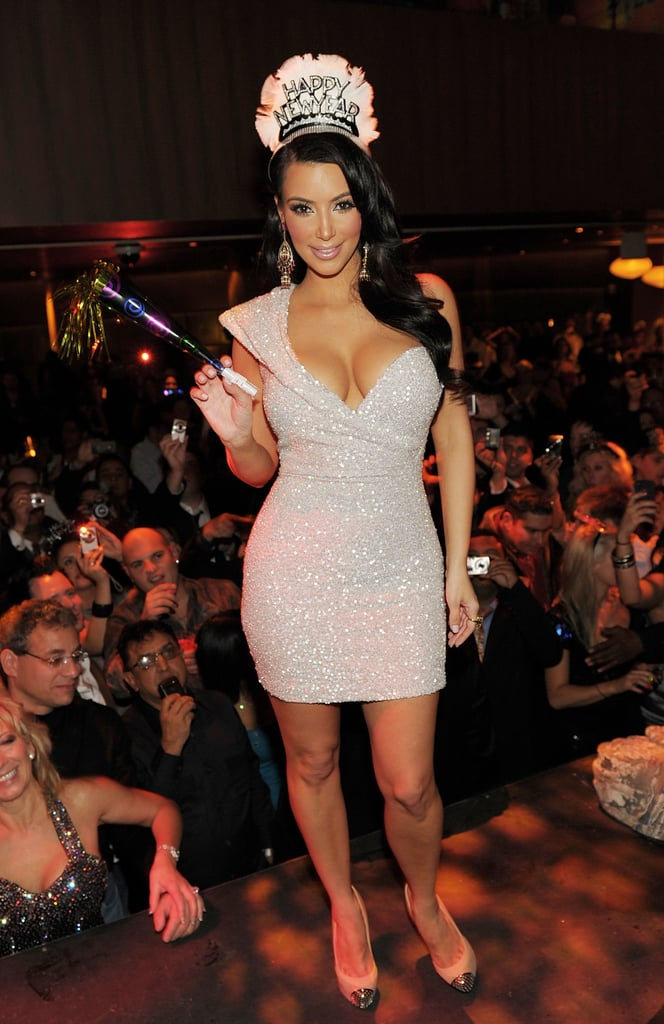 Kim Kardashian hosted a Vegas bash in a short and sparkly Marc Bower dress.