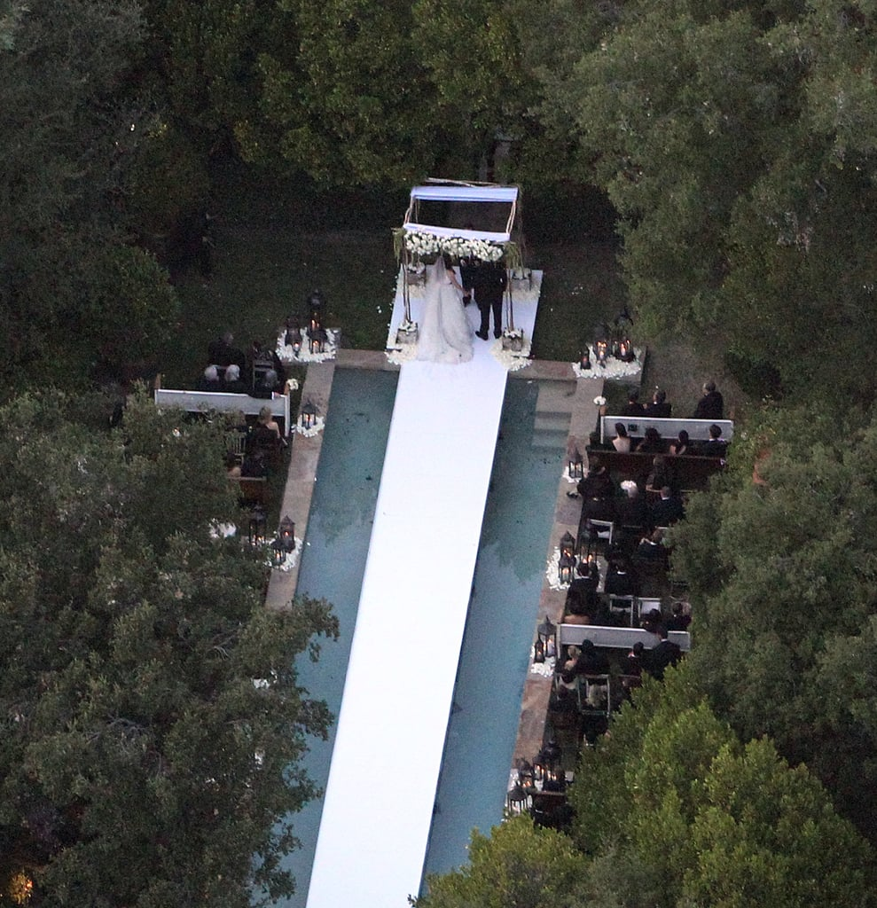The wedding aisle was built over a pool.