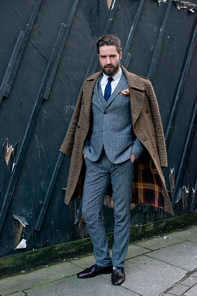 This kind of dapper suit and nonchalantly layered overcoat wouldn't just be a great look for your guy — take notes and steal the look for yourself.