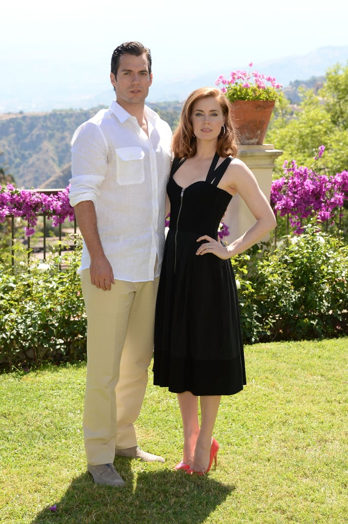 Amy Adams was retro chic in a little black bustier dress by Michael Kors and red Rupert Sanderson pumps at the Man of Steel photocall during the Taormina Film Fest in Taormina, Italy.