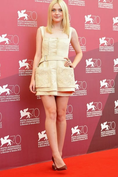 Dakota wore a cream-coloured dress at the photo call for Night Moves earlier in the day.