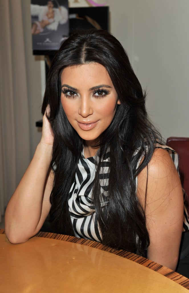 Kim Kardashian Bares Abs and Threatens to Sue Over Cheating Rumors