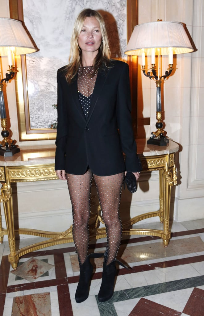 Kate Moss posed solo as she arrived at the CR Fashion Book Issue 2 launch party on Tuesday night in Paris.