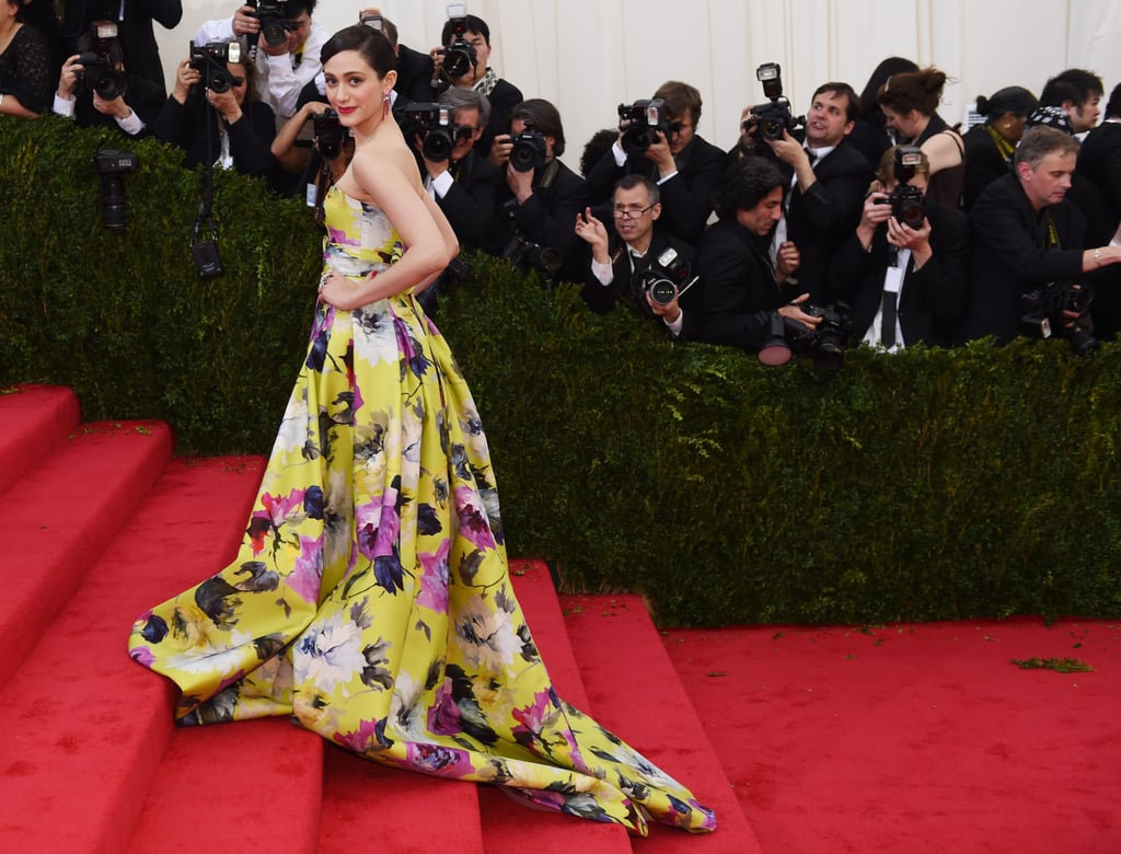 Emmy Rossum climbed the stairs in her floral gown.