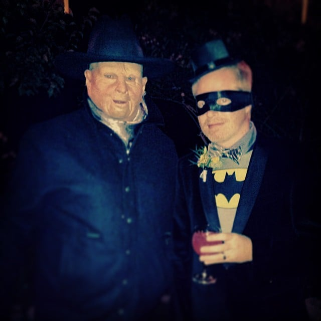 "Eric Stonestreet dressed as a ""scary ranch boss"" and posed alongside his Modern Family costar Jesse Tyler Ferguson as Batman. Source: Instagram user ericstonestreet"