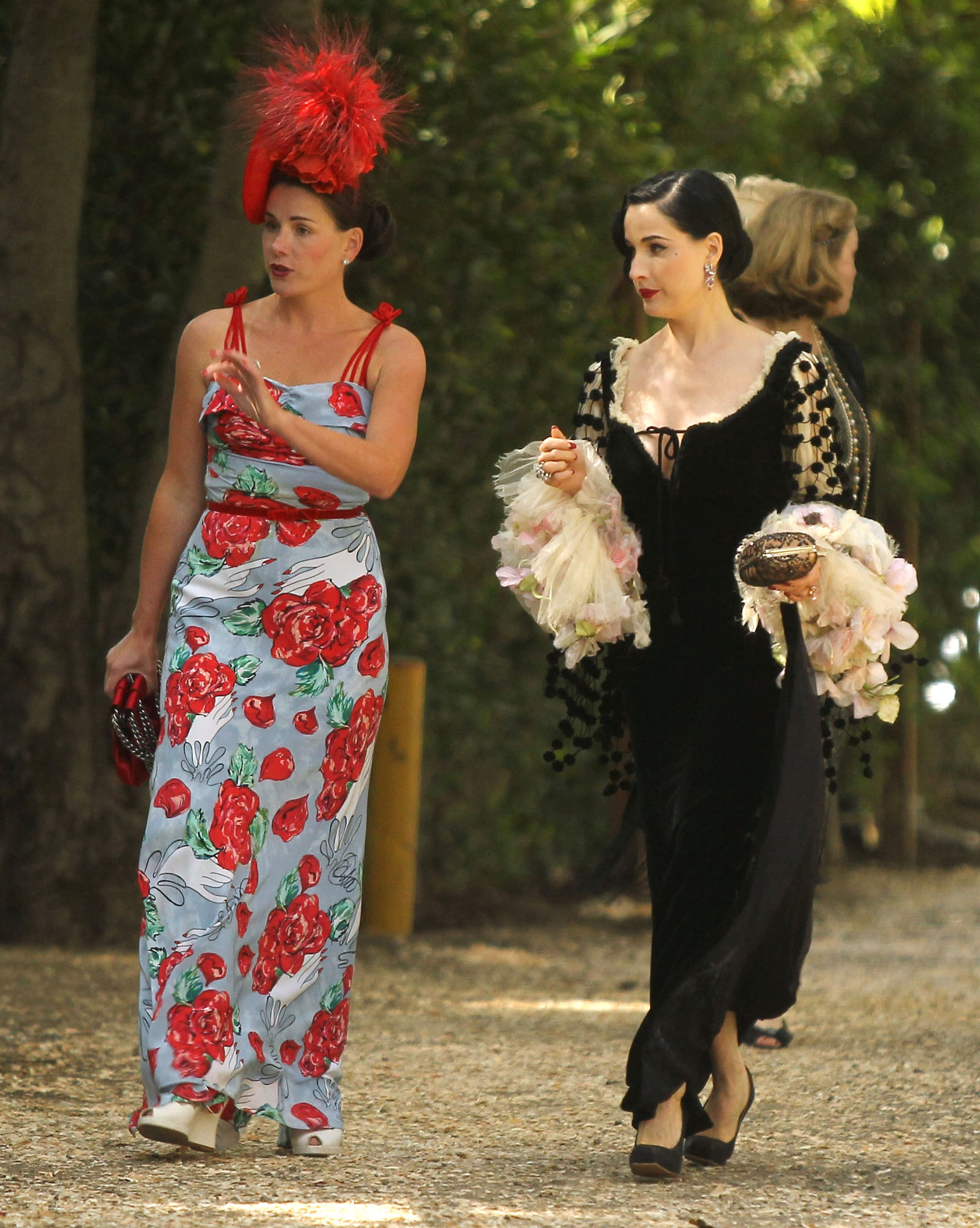 Dita Von Teese attended Aaron Paul and Lauren Parsekian's Malibu wedding in May wearing a black gown that only a burlesque queen could pull off. Get Dita's vintage-inspired feel with an equally whimsical gown, preferably with adorable pom-poms.