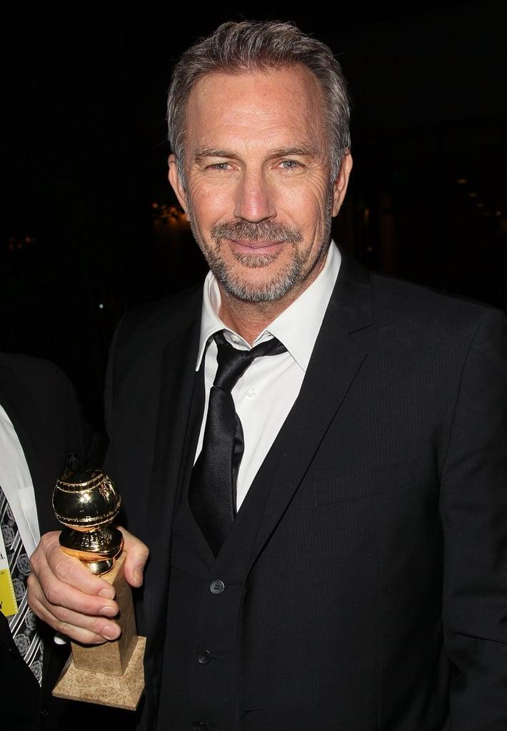 Veteran Golden Globe goer Kevin Costner posed for cameras after the award show.