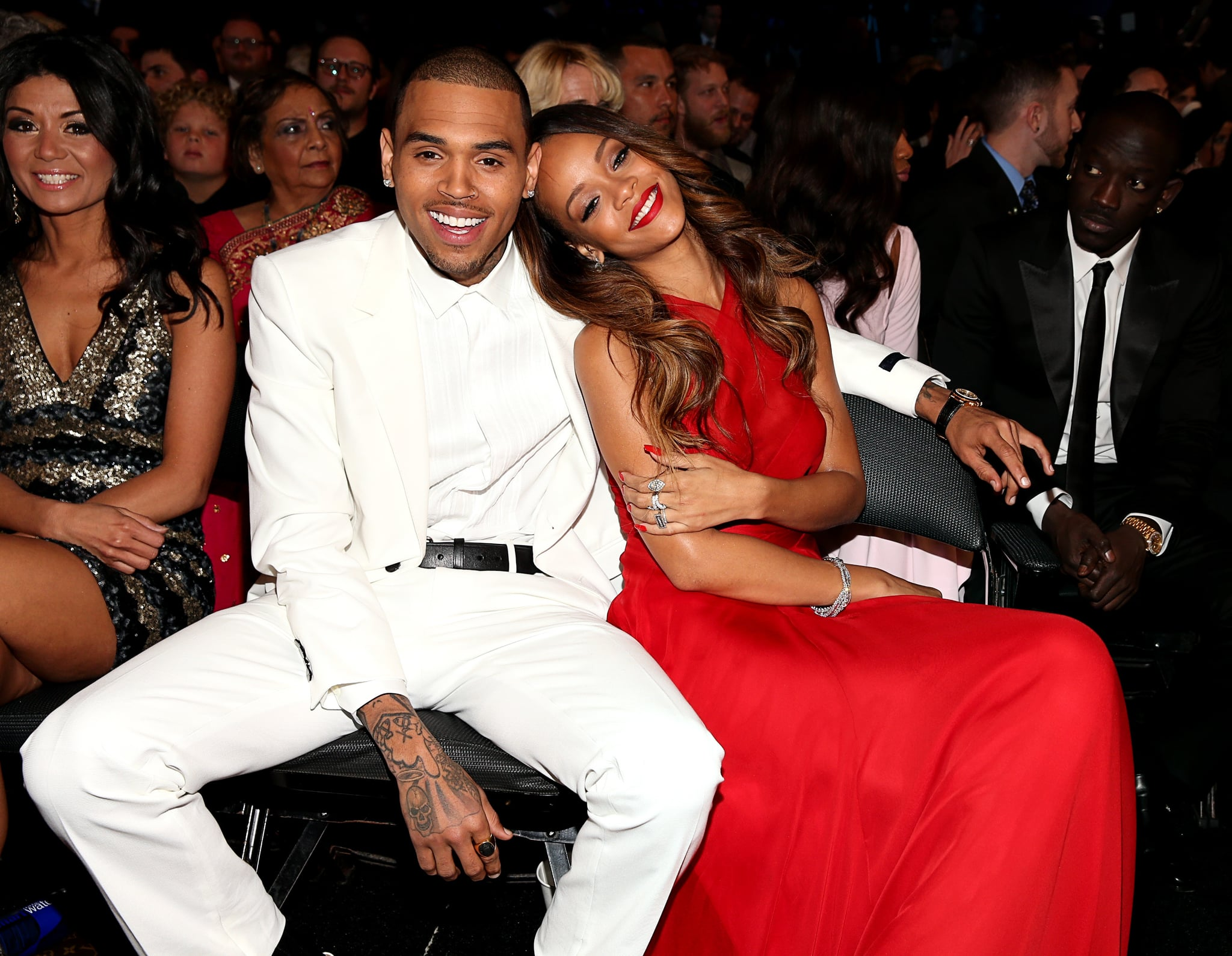Chris Brown and Rihanna cuddled up in the front row on Sunday night at the Grammys.