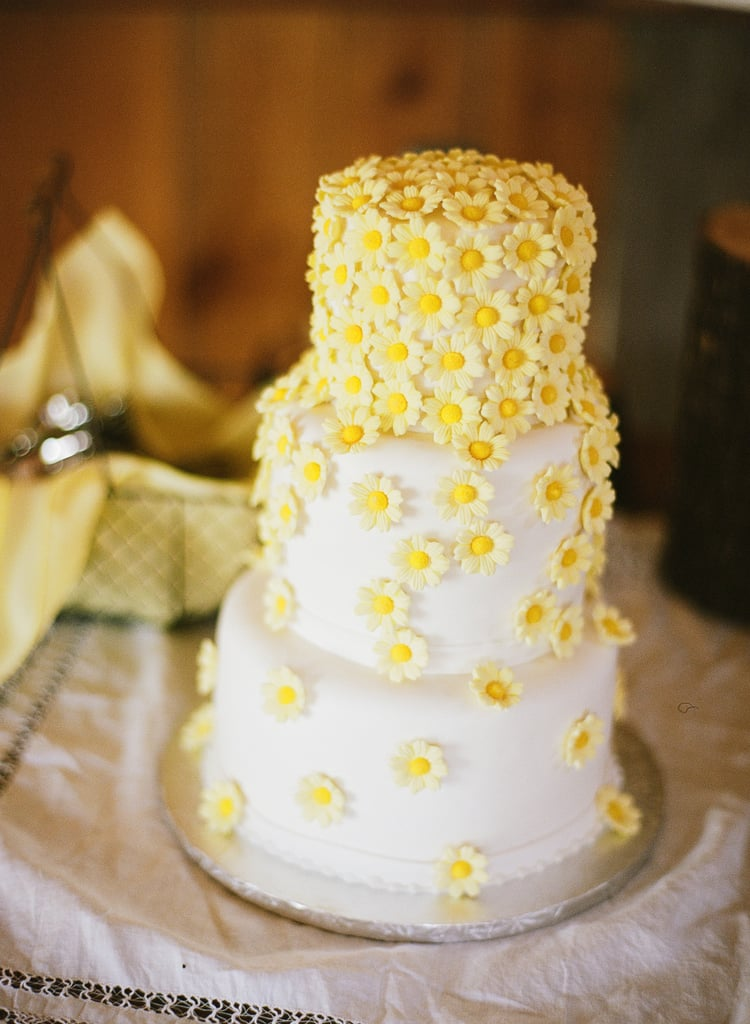 What better way to leave a lasting impression than with bright cascading daisies on a cake?