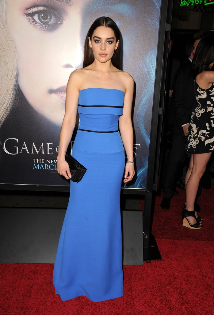 Emilia Clarke's blue strapless Victoria Beckham gown has an expected bridesmaid silhouette, but the two black stripes give it that modern kick. With this kind of modern glam, the bride should also wear something unexpected.