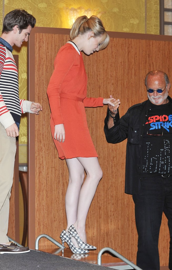 Emma Stone was helped off the stage by her costars at the press conference for The Amazing Spider-Man in Japan.