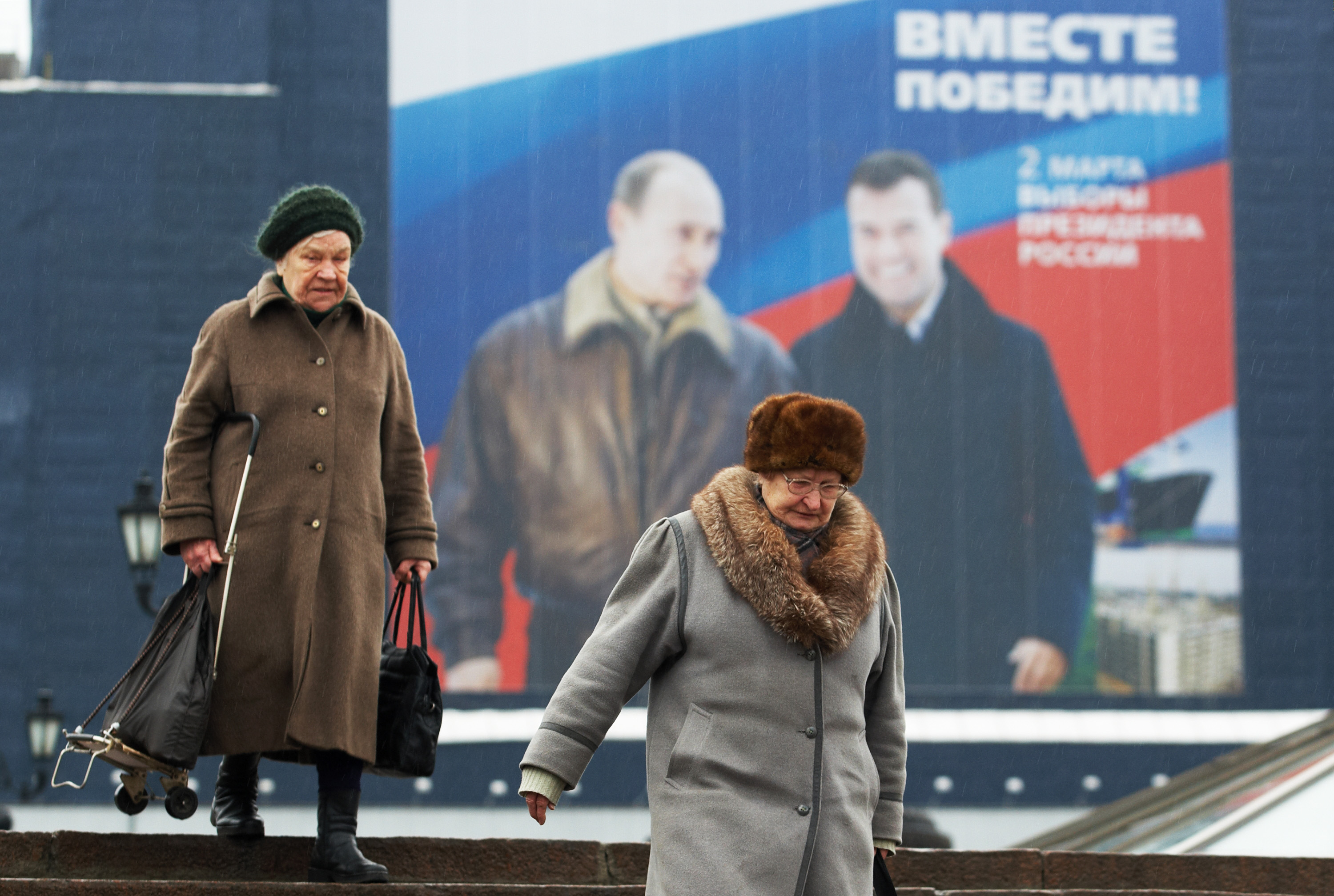 "Putin with likely successor Dmitry Medvedev. Poster says ""Together we will win!"""
