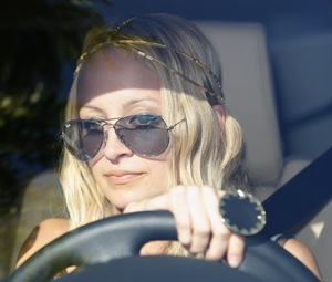 Nicole Richie Driving Wearing a Ring From Her Mysterious Jewelry Line House of Harlow 1960