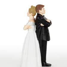 Do you really want to start your marriage off with a cake topper that shows everyone how angry you are at each other ($14.95). If you're a couple who fights all the time, maybe you should try couple's therapy first?