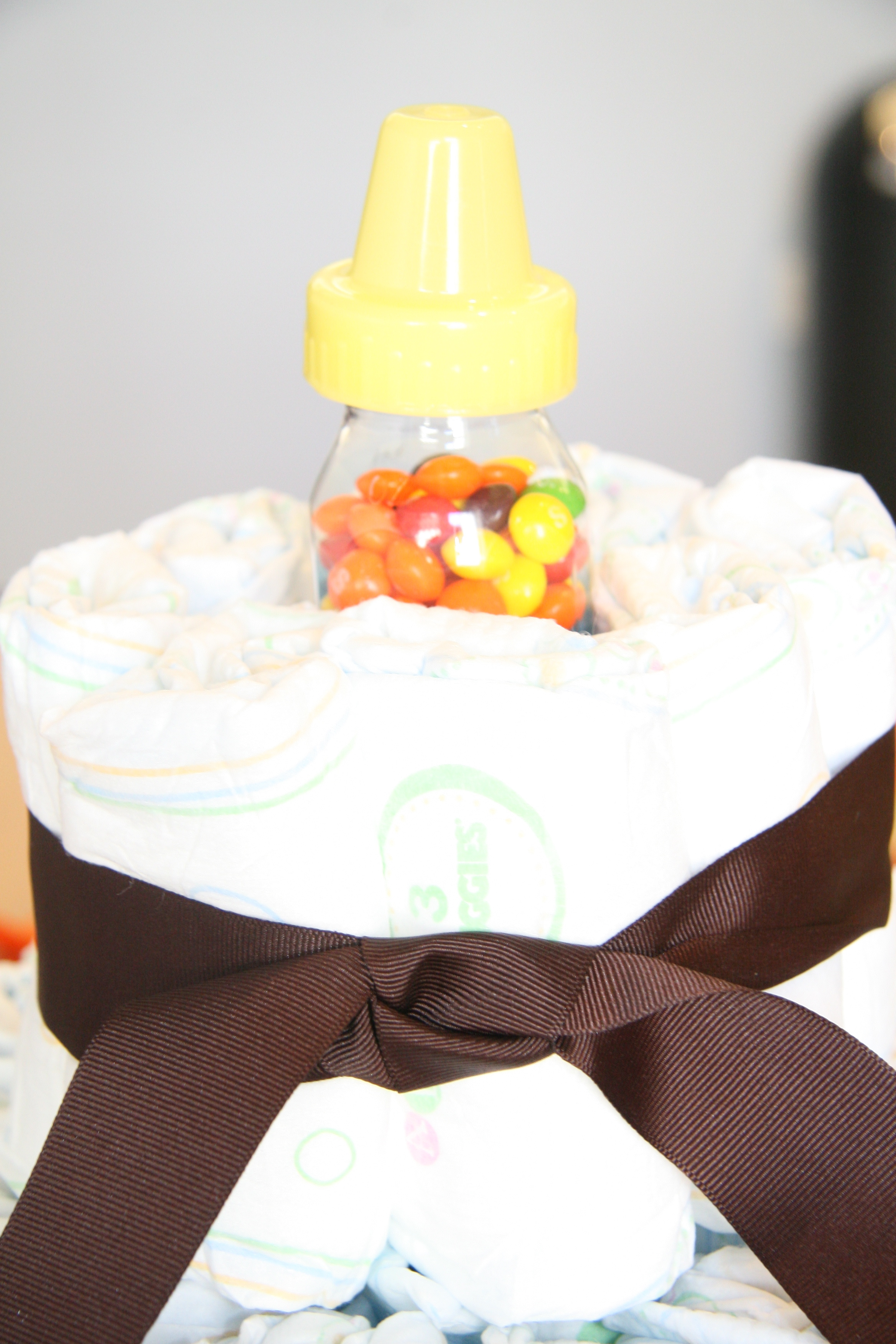 Instead of filling the top layer with diapers, put a candy filled bottle in the center.