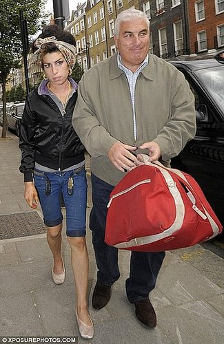 'Amy's covered in nicotine patches and eating like a horse,' reveals Winehouse's father
