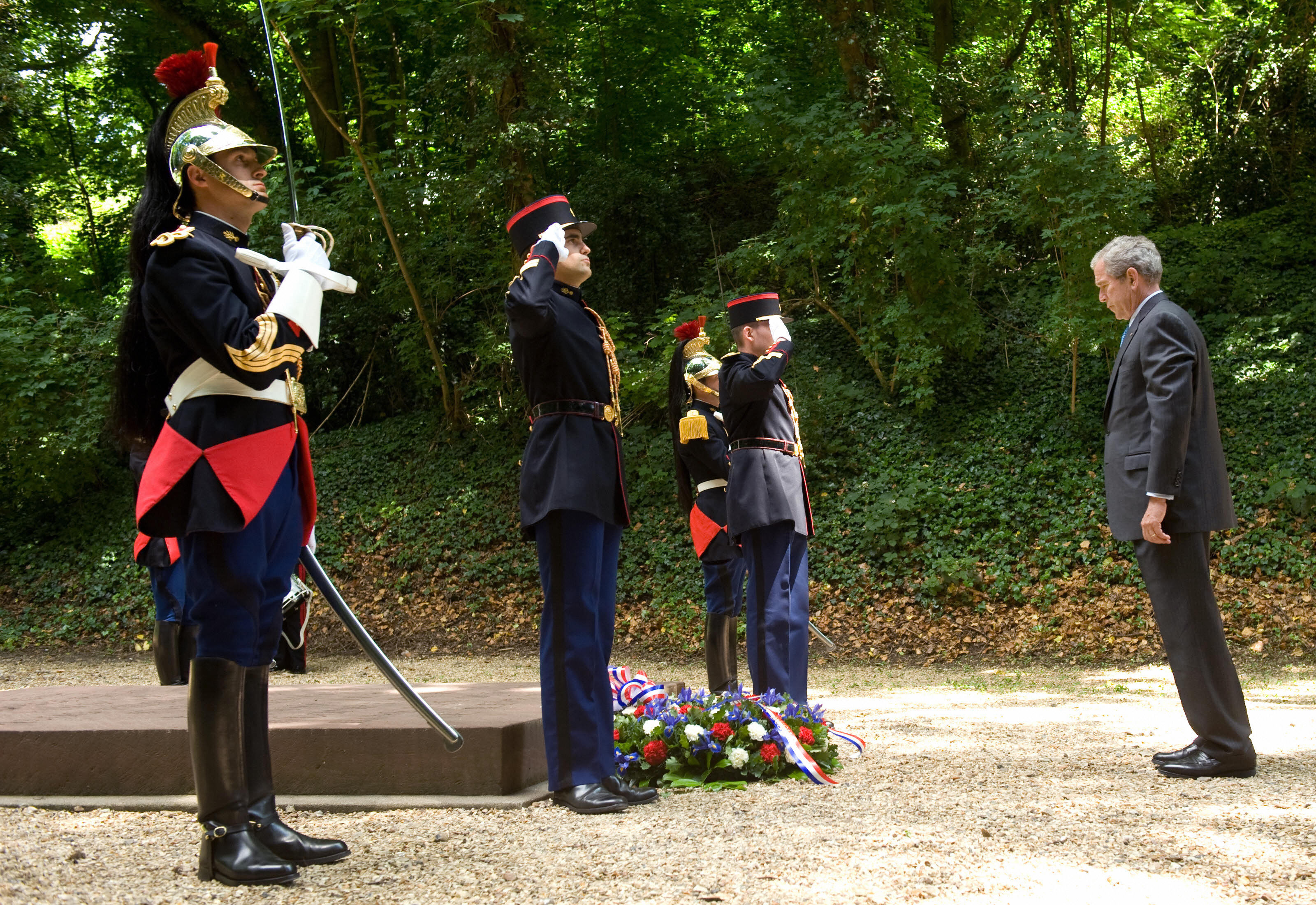 Bush pauses at a memorial to the French Resistance after laying a wreath. Vive la resistance!
