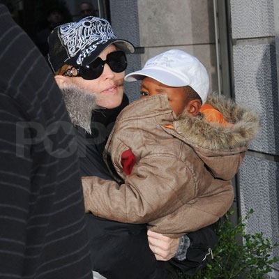 Madonna and David Cover Their Heads