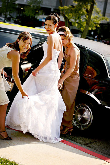 A friend and my bridesmade helping me into the limo