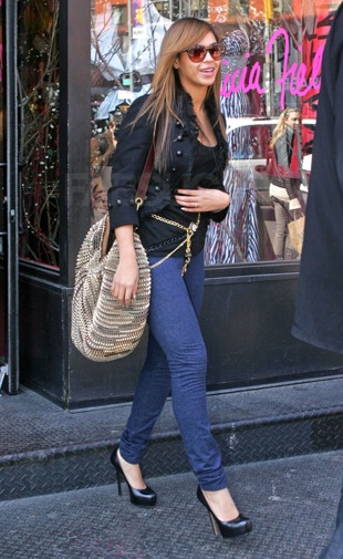 Beyonce Shops at Patricia Field in NYC Carrying Diane von Furstenberg's Gold Metallic Hobo Bag