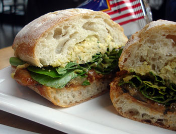 Chopped Chickpeas Sandwich With Roasted Red Peppers, Black Olives, Lemon Confit, and Parsley