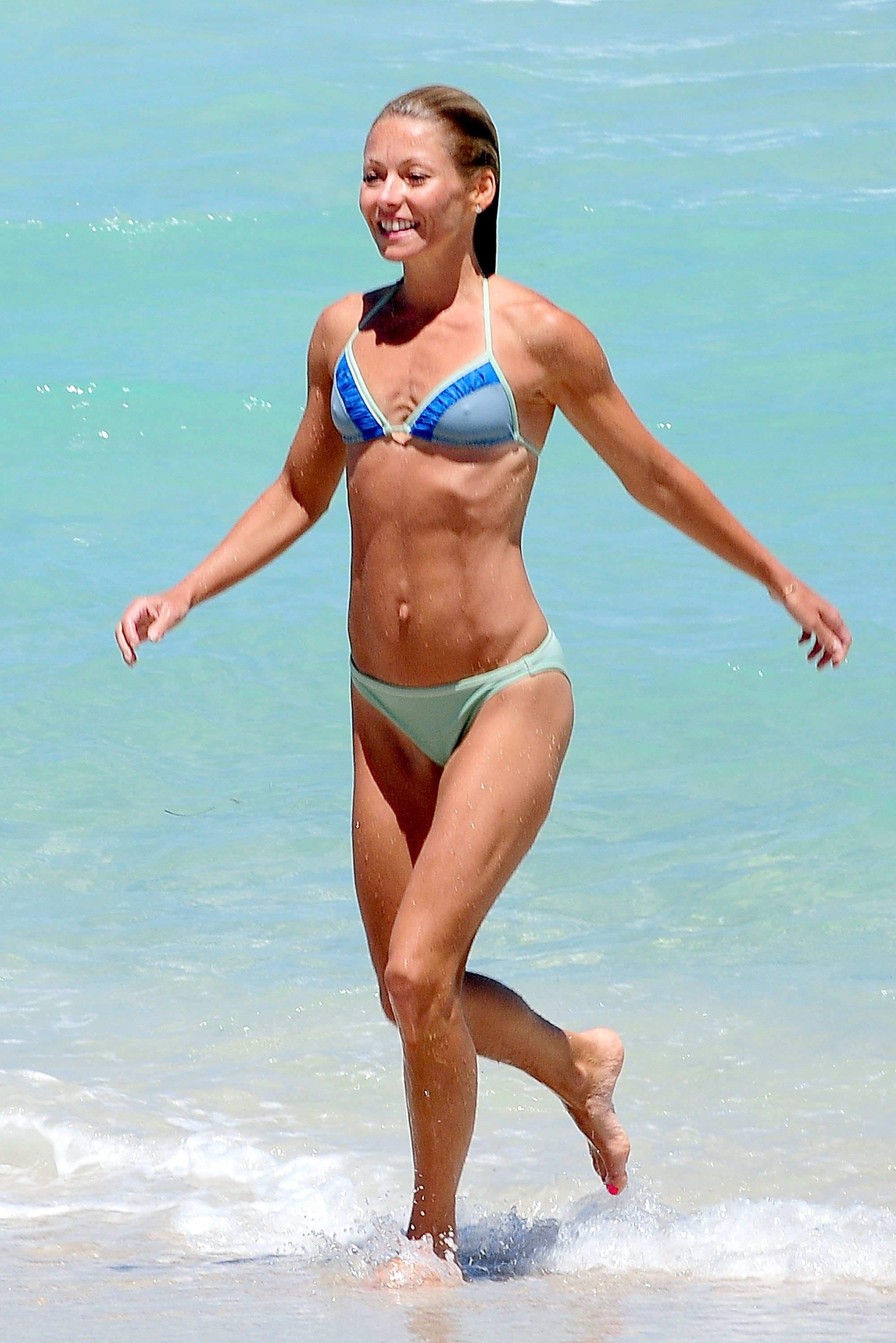 With her slim body and Regular blond hairtype without bra (cup size 32A) on the beach in bikini