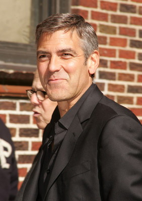 Clooney Poses With Police