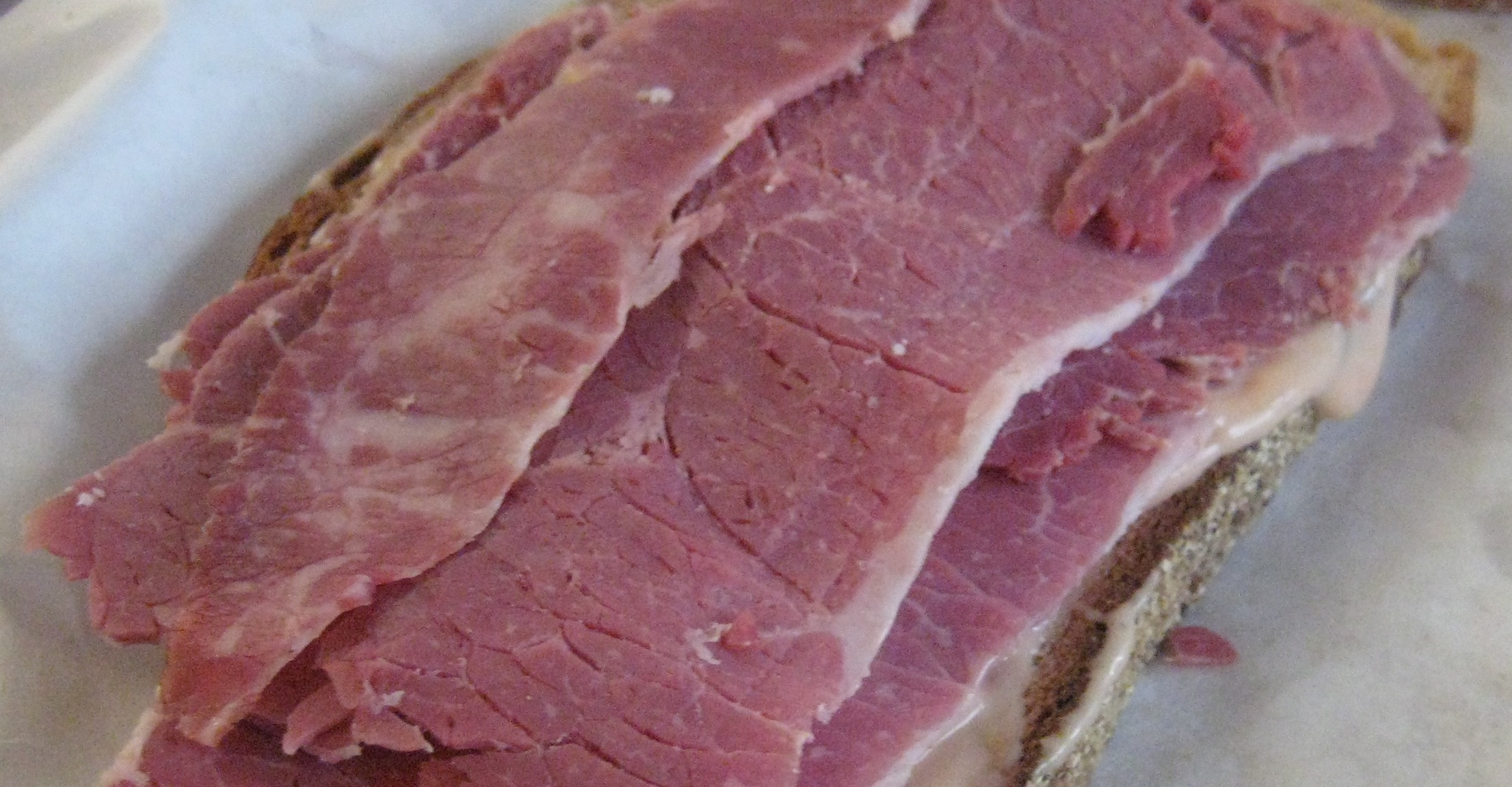 Layer 3-5 slices of meat on top of one slice of bread.