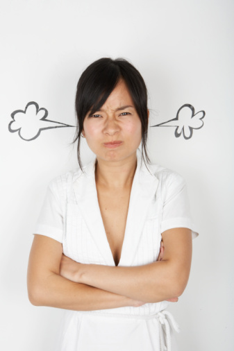 What is the average amount of time a day a young woman spends in a bad mood?